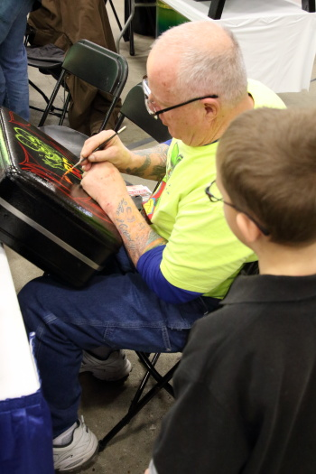 Our grandson enjoyed watching this particular pin stripper doing Rat Fink on a suitcase