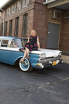 Sara Barnard sitting on the front hood of her 1959